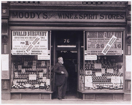 Photo of Edward Moody standing outside 'Moody's Wine and Spirit Stores, 1908 Birkenhead, Merseyside England